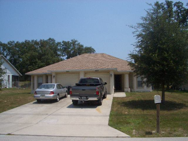 spring hill duplex for sale